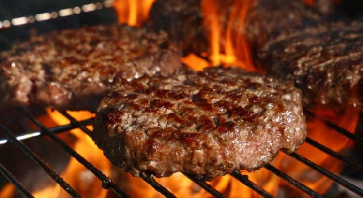 juicy burgers on grill